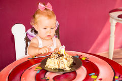 Little happy baby girl celebrating first birthday. Kid and her first cake on party. Childhood. Stock Photo