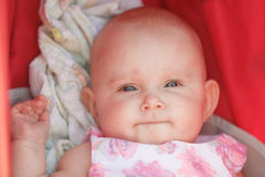 Little happy baby in stroller Stock Images