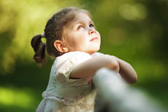 Little happy beautiful girl looking up Royalty Free Stock Image