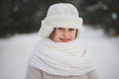 Little happy beautiful girl in winter forest stock photo