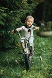 Little happy boy on bike Royalty Free Stock Photo