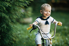 Little happy boy on bike Stock Photography