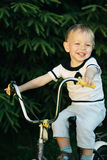 Little happy boy on bike Royalty Free Stock Photos