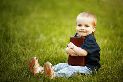 Little happy boy with book Stock Photography