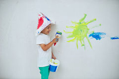 Little happy boy with colorful brush Royalty Free Stock Images