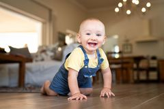 Little happy boy crawling on floor royalty free stock photo
