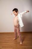 Little happy boy dancing like flying. Little happy boy singing and dancing like flying stock image