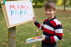 Little happy boy drawing in park Royalty Free Stock Photo