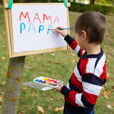 Little happy boy drawing in park Royalty Free Stock Images