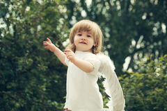 Little happy boy dressed as angel Royalty Free Stock Images
