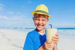 Little boy drinking cocktail on tropical beach Royalty Free Stock Images