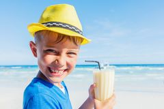 Little boy drinking cocktail on tropical beach Royalty Free Stock Photography