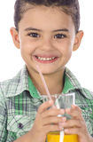 Little Happy Boy Drinking A Glass of Juice stock photography