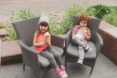 Happy boy and girl with icecream. Little happy boy and girl with icecream Stock Images