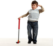 Little happy boy plays mini golf Royalty Free Stock Image