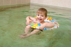 Little happy boy in pool Royalty Free Stock Image