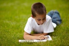 Little happy boy reading book Royalty Free Stock Photo