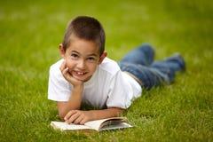 Little happy boy reading book Royalty Free Stock Photos