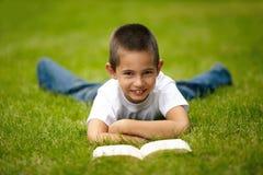 Little happy boy reading book Stock Image
