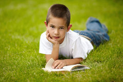 Little happy boy reading book Royalty Free Stock Photography