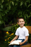 Little happy boy reading book Stock Photography