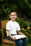 Little happy boy reading book Stock Images