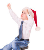 Little happy boy in red santa hat Royalty Free Stock Photo