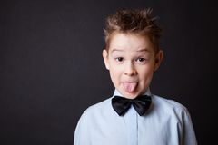 Little happy boy showing his tongue Royalty Free Stock Images