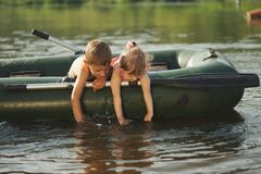 Happy boy swimming in fishing boat Royalty Free Stock Images