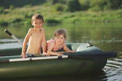 Happy boy swimming in fishing boat. Little happy boy swimming in fishing boat Royalty Free Stock Image