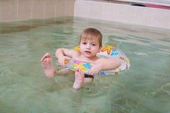 Little happy boy swimming in pool Stock Photo