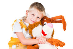Little happy boy with toy rabbit isolated on white Royalty Free Stock Image