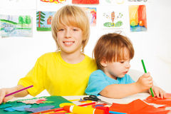 Little happy boys play with paper Stock Images