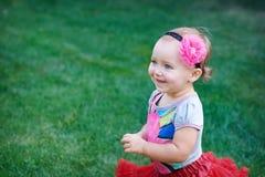 Little happy cheerful girl running around playing and having fun Stock Photos