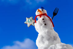 Little happy christmas snowman with cookie star outdoor. Winter season. Stock Photography