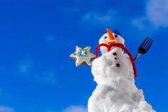 Little happy christmas snowman with cookie star outdoor. Winter season. Royalty Free Stock Photos