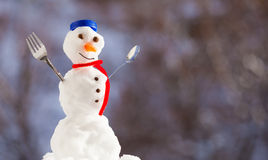 Little happy christmas snowman with fork outdoor. Winter season. Stock Image
