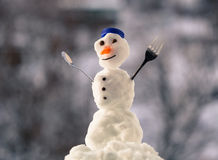 Little happy christmas snowman with fork outdoor. Winter season. Royalty Free Stock Photos