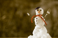Little happy christmas snowman with fork outdoor. Winter season. Royalty Free Stock Image