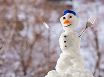 Little happy christmas snowman with fork outdoor. Winter season. Royalty Free Stock Photo
