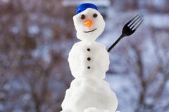Little happy christmas snowman with fork outdoor. Winter season. Stock Images