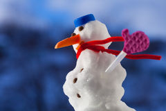 Little happy christmas snowman with pink gloves outdoor. Winter season. Royalty Free Stock Photo
