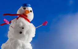 Little happy christmas snowman with pink gloves outdoor. Winter season. Royalty Free Stock Images