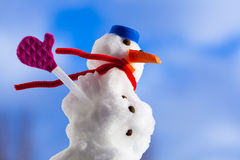 Little happy christmas snowman with pink gloves outdoor. Winter season. Stock Photos