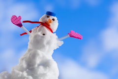 Little happy christmas snowman with pink gloves outdoor. Winter season. Stock Photo