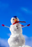Little happy christmas snowman with pink gloves outdoor. Winter season. Royalty Free Stock Photography