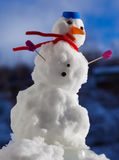 Little happy christmas snowman with pink gloves outdoor. Winter season. Royalty Free Stock Photos