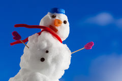 Little happy christmas snowman with pink gloves outdoor. Winter season. Stock Photography