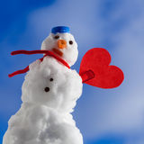 Little happy christmas snowman red heart love symbol outdoor. Winter. Royalty Free Stock Photos