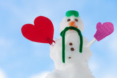 Little happy christmas snowman red heart love symbol outdoor. Winter. Royalty Free Stock Photography